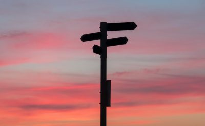 silhouette of signposts implying making decisions