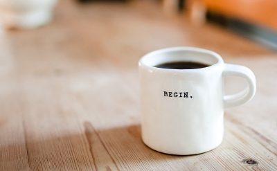 Coffee mug with word Begin on it
